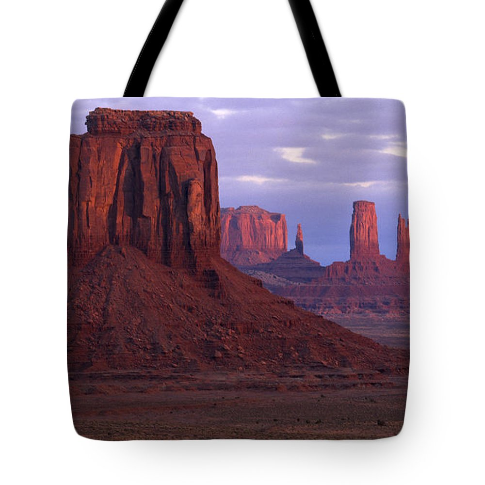 Monument Valley Tote Bag featuring the photograph Dawn At Monument Valley by Sandra Bronstein