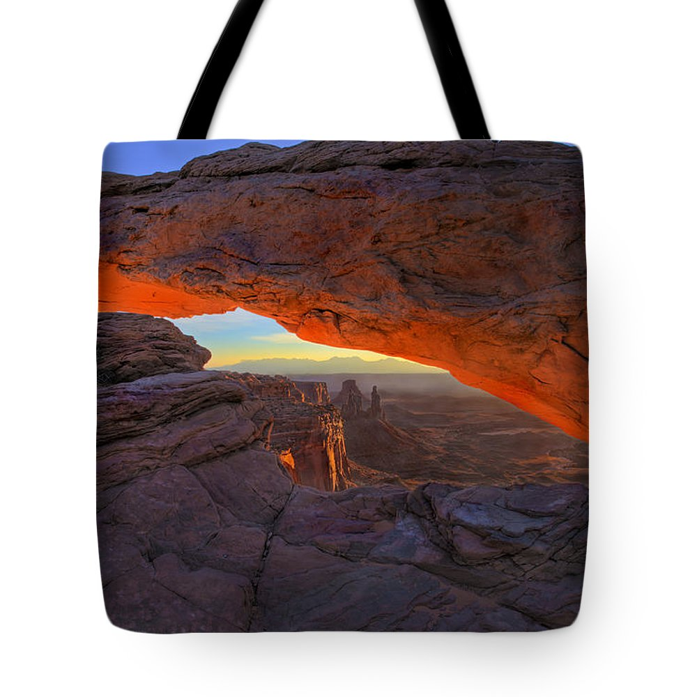 Mesa Arch Tote Bag featuring the photograph Dawns Early Light by Mike Dawson