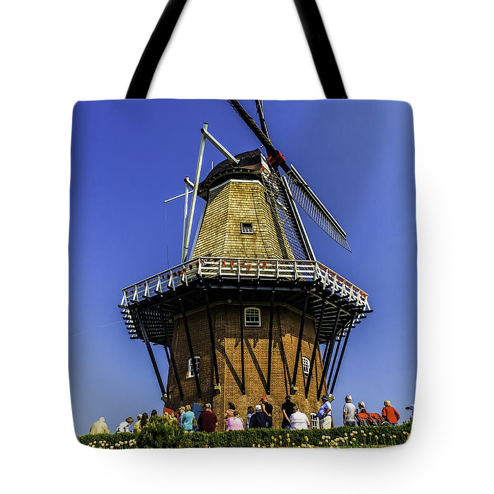 Holland Tote Bag featuring the photograph De Zwaan Windmill In Holland by Nick Zelinsky