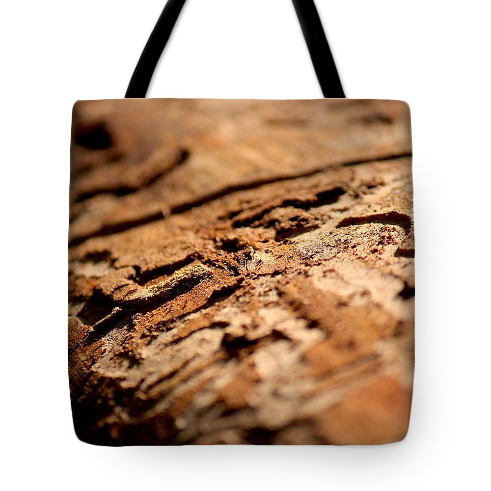 Adventure Tote Bag featuring the photograph Debarked Tree by Nicholas Miller