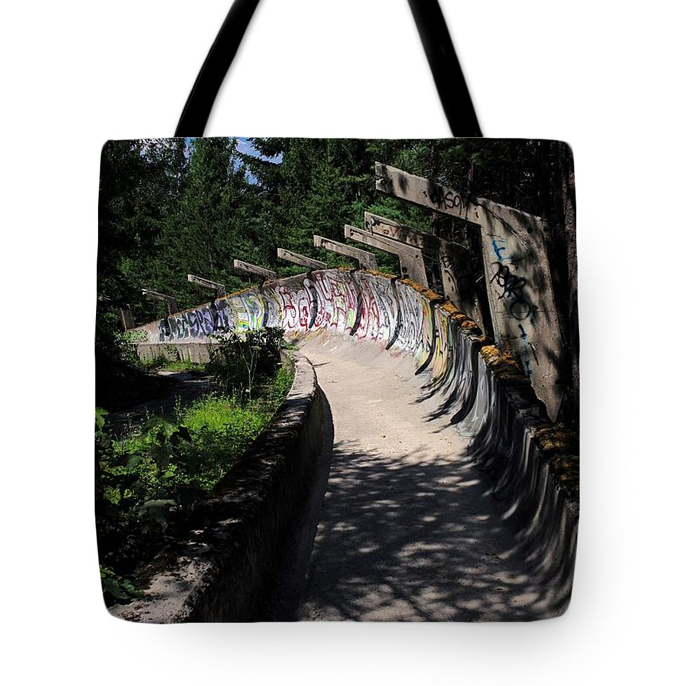Europe Tote Bag featuring the photograph Decayed Bobsled by Piotr Kuzniar