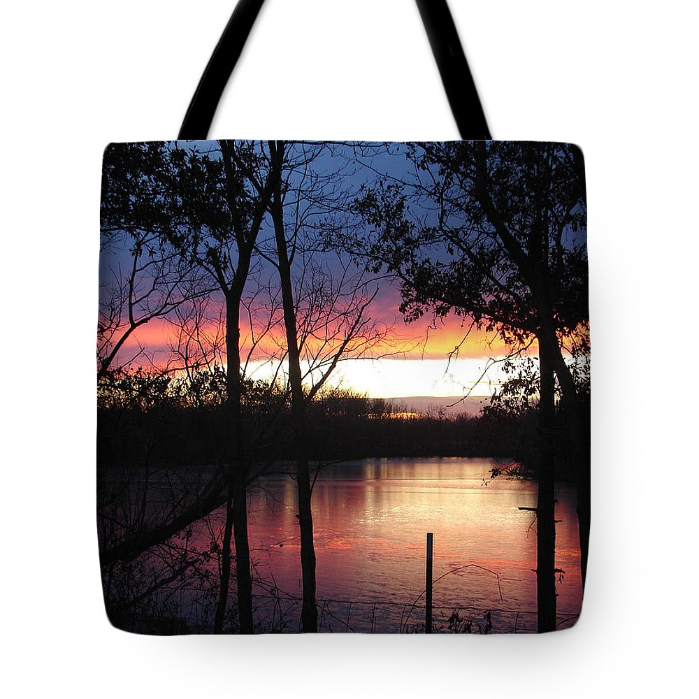 Red Gold Blue Lake Trees Tote Bag featuring the photograph December Sunset by Luciana Seymour