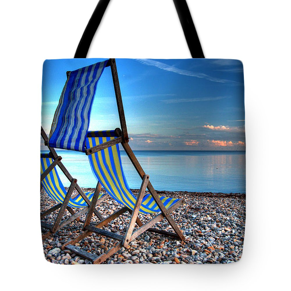 Deckchairs Tote Bag featuring the photograph Deckchairs On The Shingle by Rob Hawkins