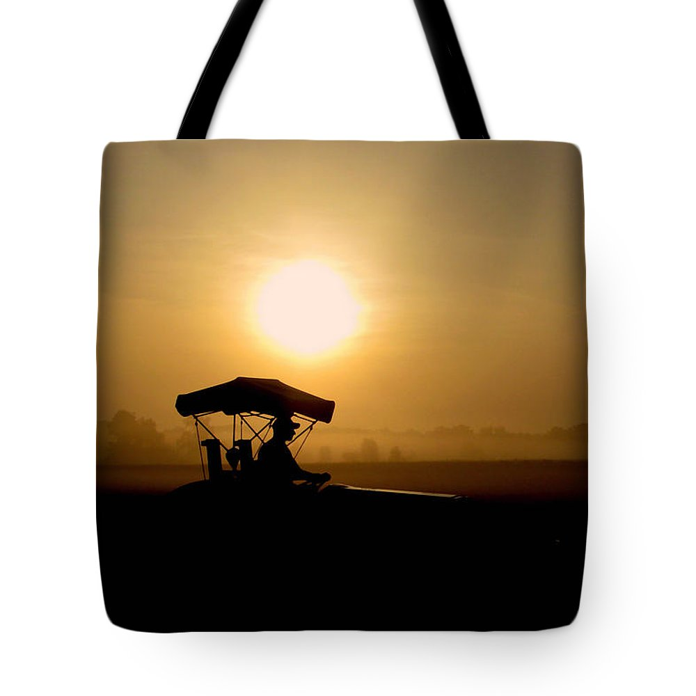 Farming Tote Bag featuring the photograph Dedication Of A Farmer by Peg Urban