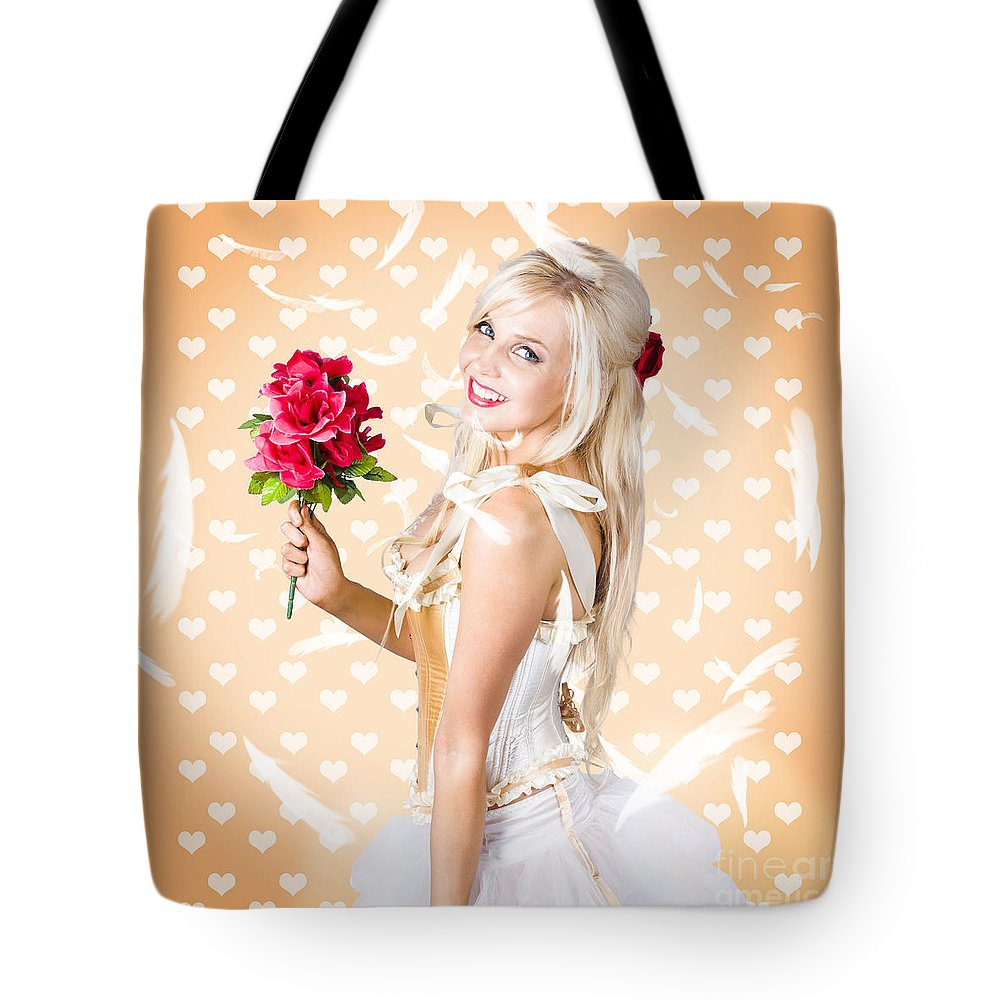 Romance Tote Bag featuring the photograph Delicate Young Woman Holding Flower Bunch by Jorgo Photography - Wall Art Gallery