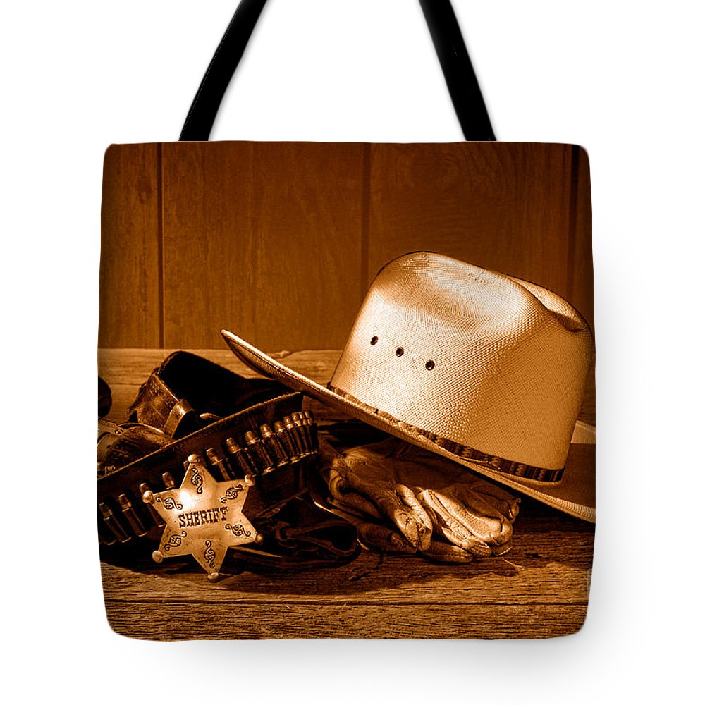Sheriff Tote Bag featuring the photograph Deputy Sheriff Gear - Sepia by Olivier Le Queinec