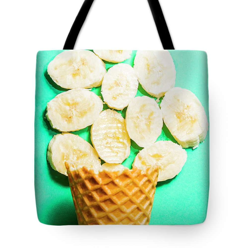 Banana Tote Bag featuring the photograph Dessert Concept Of Ice-cream Cone And Banana Slices by Jorgo Photography - Wall Art Gallery