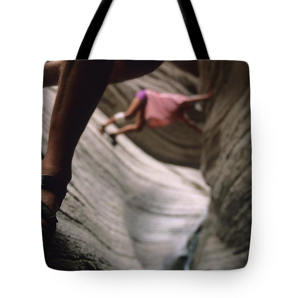 Adventure Tote Bag featuring the photograph Detail Of Sandals And Hikers In A Slot by Bobby Model