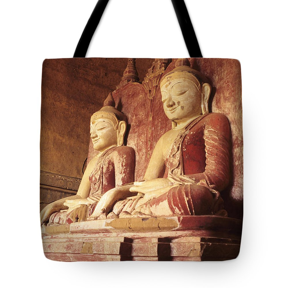 Angle Tote Bag featuring the photograph Dhammayangyi Temple Buddhas by Gloria & Richard Maschmeyer - Printscapes