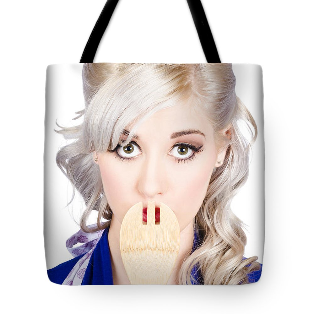 Secret Tote Bag featuring the photograph Diet Woman Covering Mouth With Secret Recipe Spoon by Jorgo Photography - Wall Art Gallery