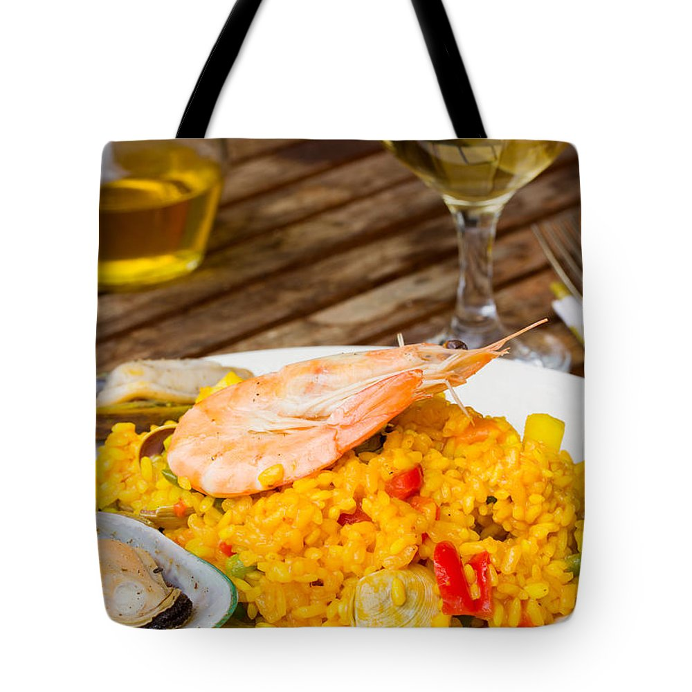 Paella Tote Bag featuring the photograph Dining With Paella by Anastasy Yarmolovich
