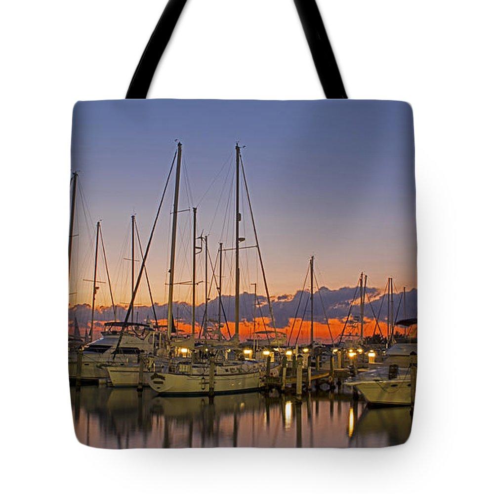#dinnerkeymarina #sunrise #miami #florida #coconutgrove #sailboats #bay #ocean #streetart #zazzle #photog #togs #fineart #deals Tote Bag featuring the photograph Dinner Key Marina 2539 by Steve Lipson