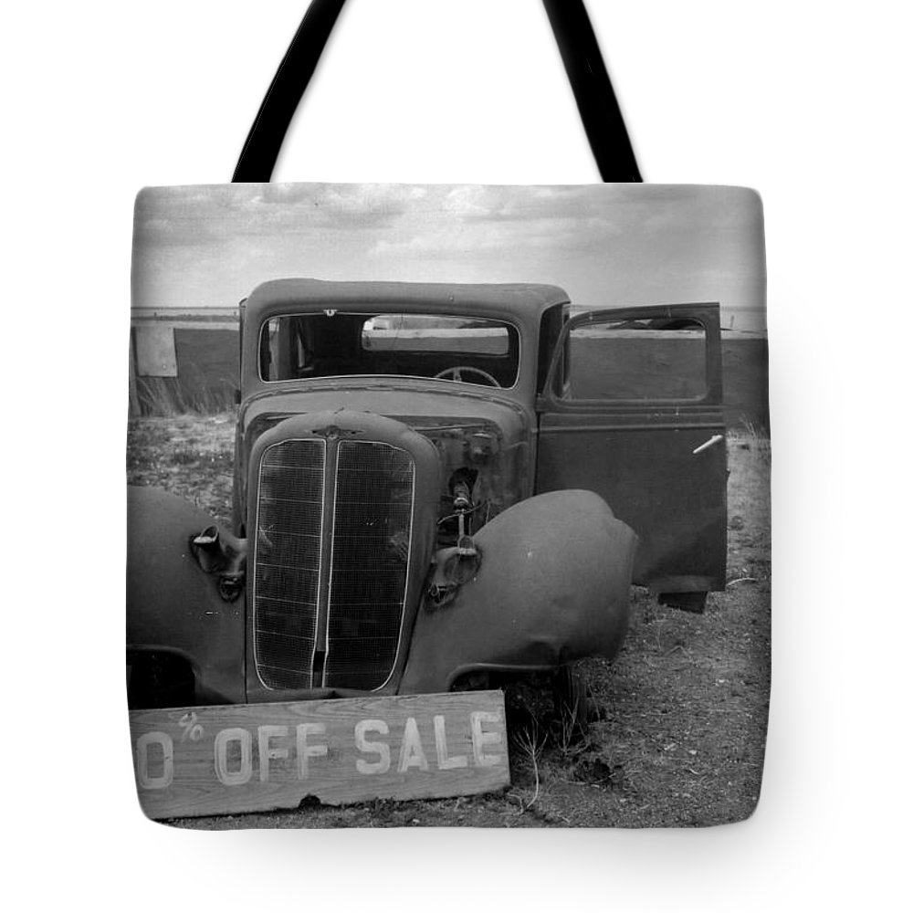 Black & White Tote Bag featuring the photograph Discounted by Crystal Nederman