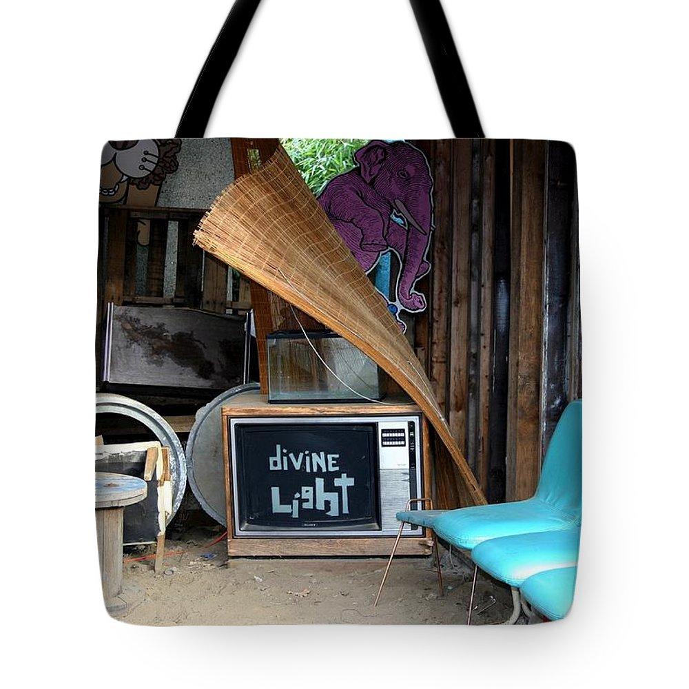 Divine Light Tote Bag featuring the photograph Divine Light by Minaz Jantz