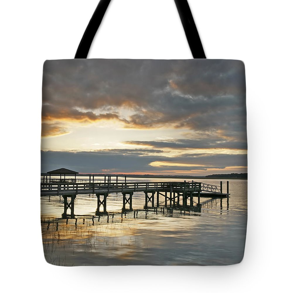 Sunset Tote Bag featuring the photograph Dock Reflections by Phill Doherty