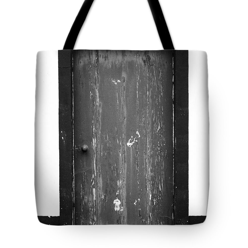 Closed Tote Bag featuring the photograph Door by Gaspar Avila