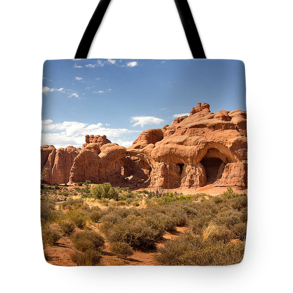 Travel Tote Bag featuring the photograph Double Arch Famous Landmark In Arches National Park Utah by Louise Heusinkveld