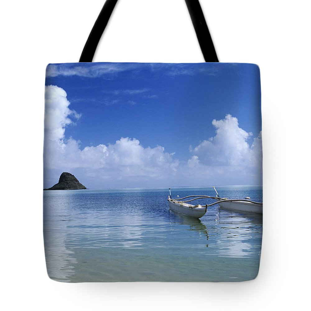 Aku Tote Bag featuring the photograph Double Hull Canoe by Joss - Printscapes