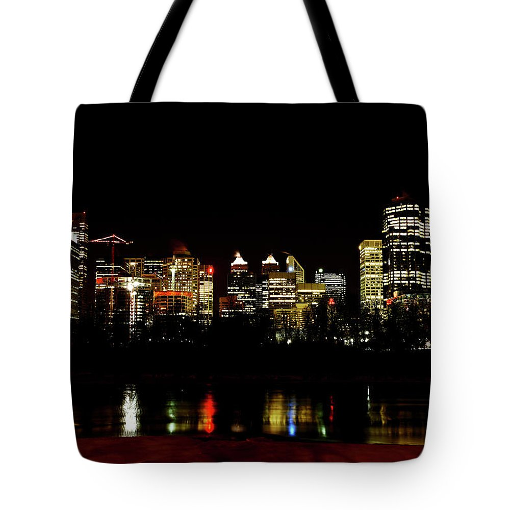 Downtown Calgary Night Lights Reflection Off Bow River Rural Alb Tote Bag featuring the digital art Downtown Calgary At Night by Mark Duffy