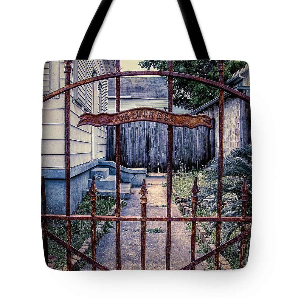 Iron Tote Bag featuring the photograph Dr. Lines Gate - Nola by Kathleen K Parker