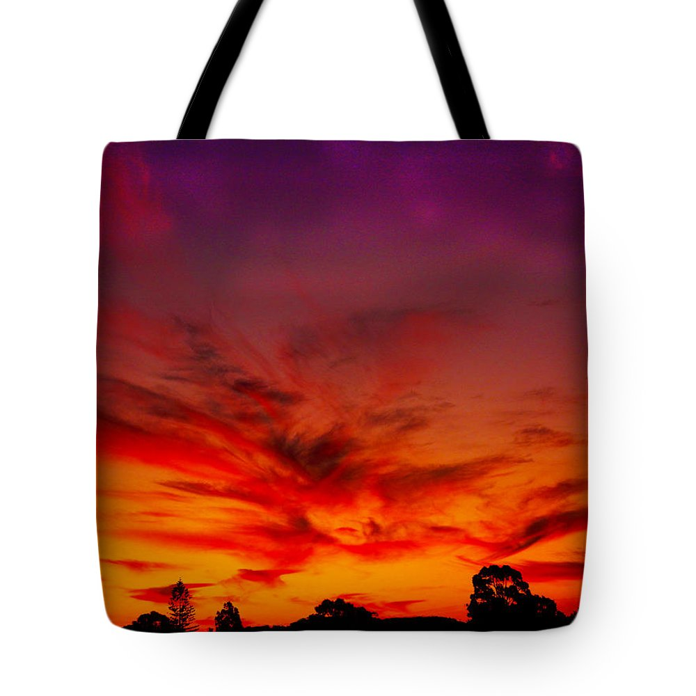 Sunset Tote Bag featuring the photograph Dragon Glow by Mark Blauhoefer