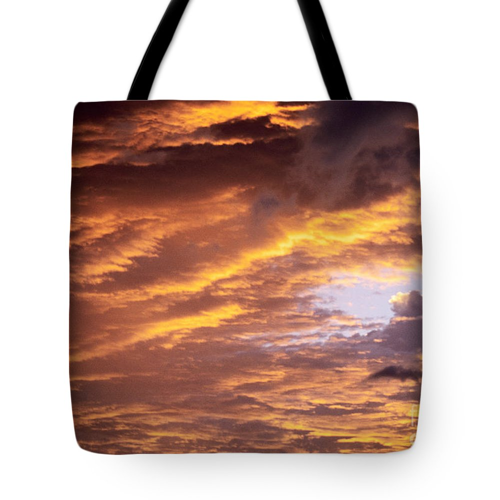 Afternoon Tote Bag featuring the photograph Dramatic Orange Sunset by Carl Shaneff - Printscapes