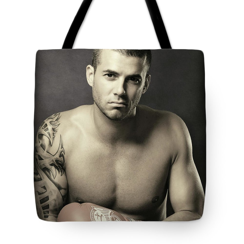 Kickboxer Tote Bag featuring the photograph Dramatic Portrait Of A Kickboxer by Oleksiy Maksymenko