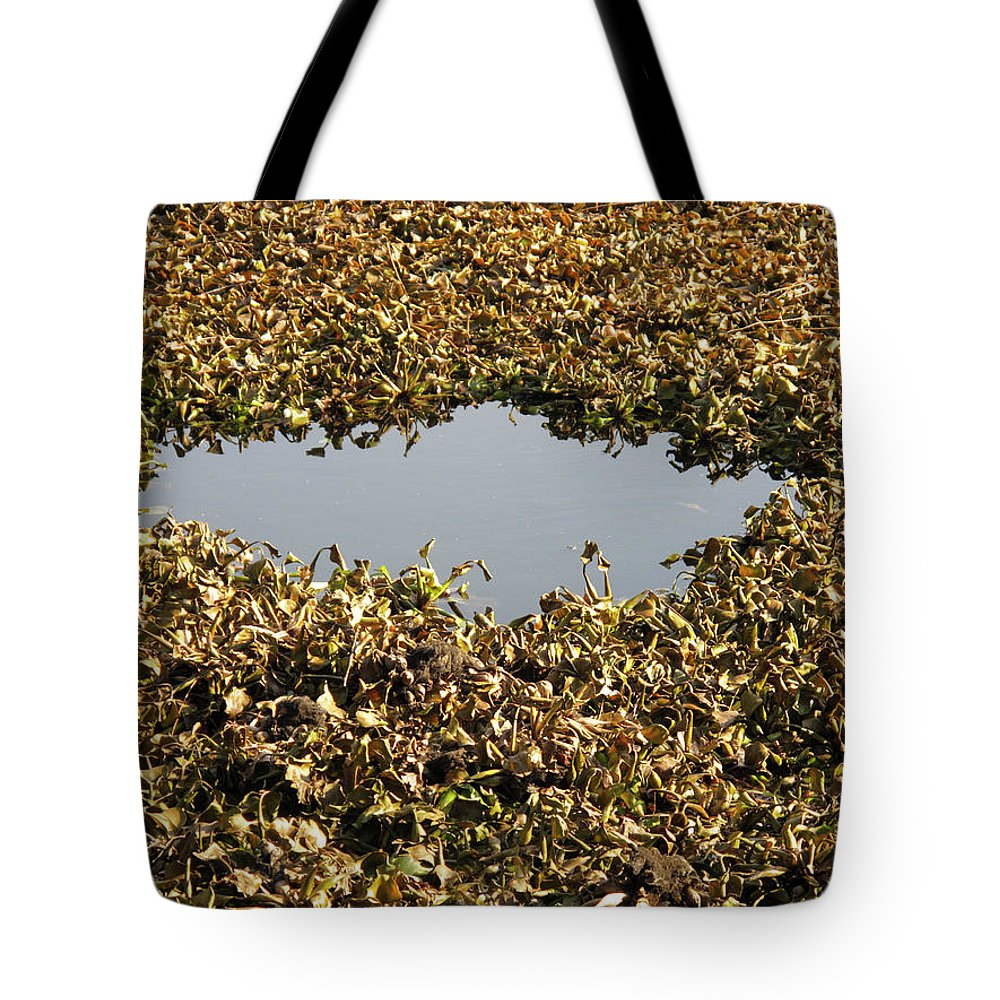 Horizontal Tote Bag featuring the photograph Dried Leaves In A Pond by Stefania Levi