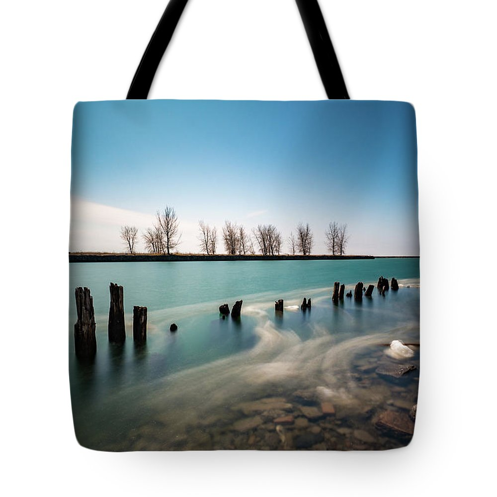 Lake Erie Tote Bag featuring the photograph Drifting Ice by Dave Niedbala