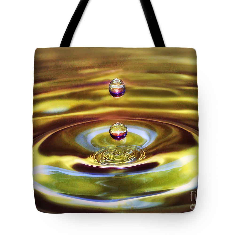 Drops Tote Bag featuring the photograph Drip Drop by Arnie Goldstein