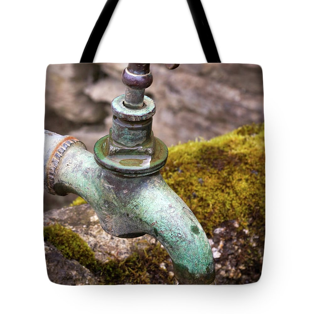 Dripping Tote Bag featuring the photograph Dripping Tap On A Stone Trough by Louise Heusinkveld