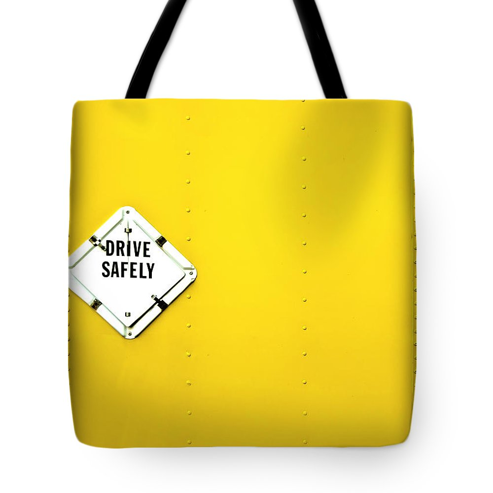 Bright Tote Bag featuring the photograph Drive Safely by Evelina Kremsdorf