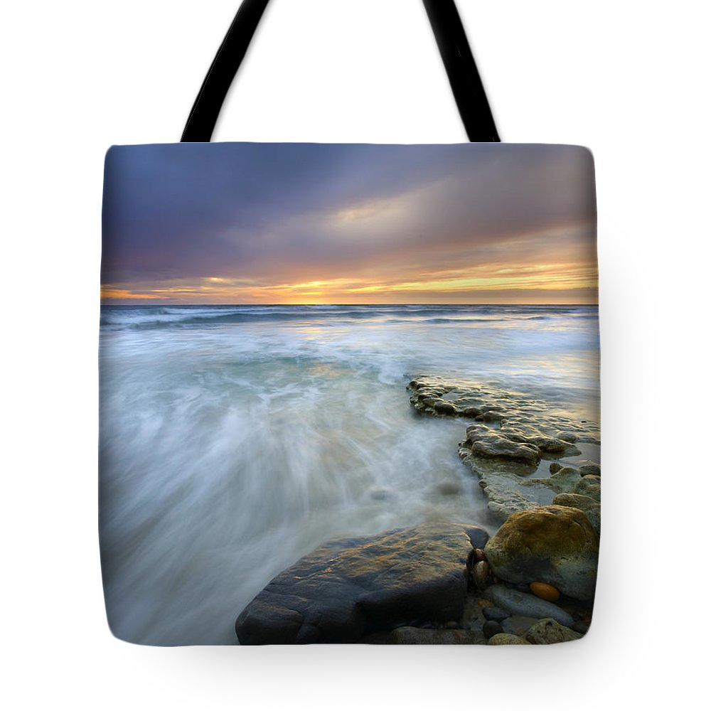 Rocks Tote Bag featuring the photograph Driven Before The Storm by Mike Dawson