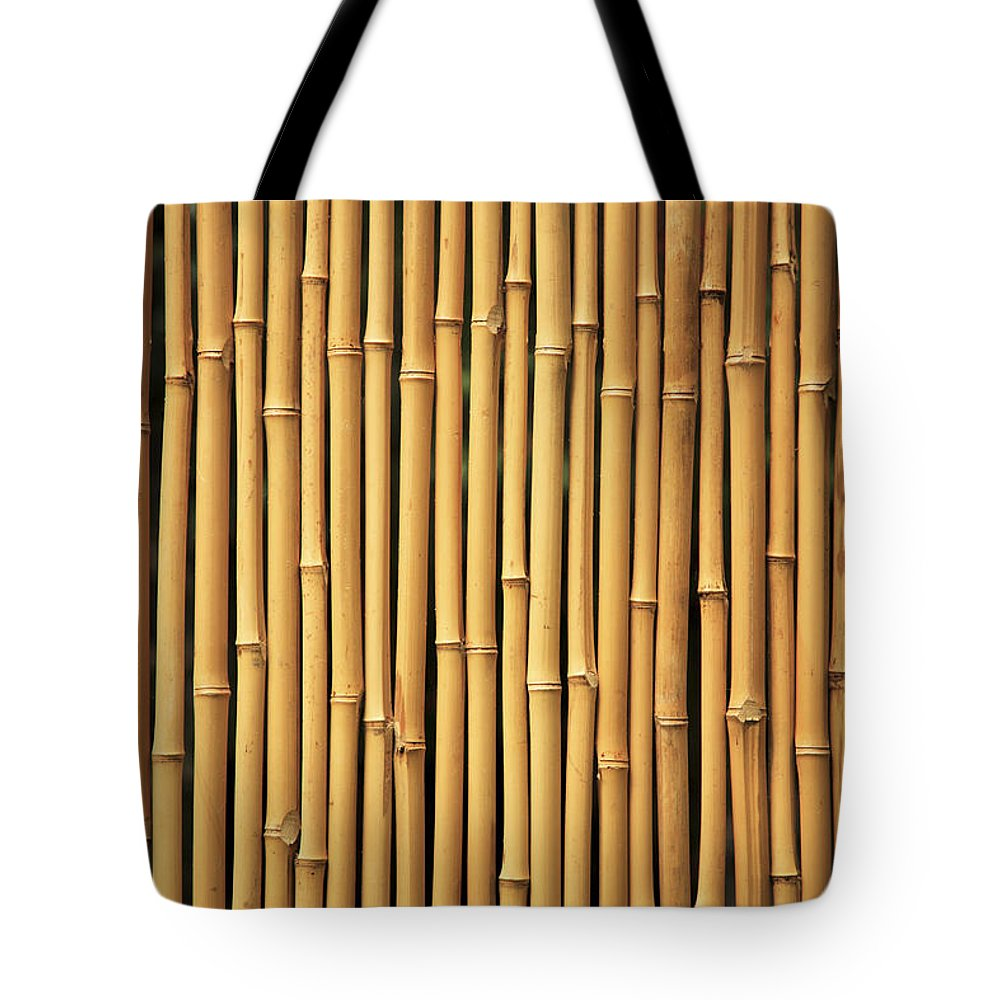 Abstract Tote Bag featuring the photograph Dry Bamboo Rows by Brandon Tabiolo - Printscapes