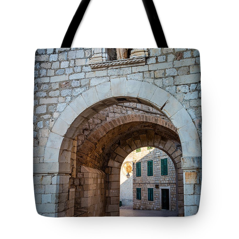 Adriatic Tote Bag featuring the photograph Dubrovnik Entrance by Inge Johnsson