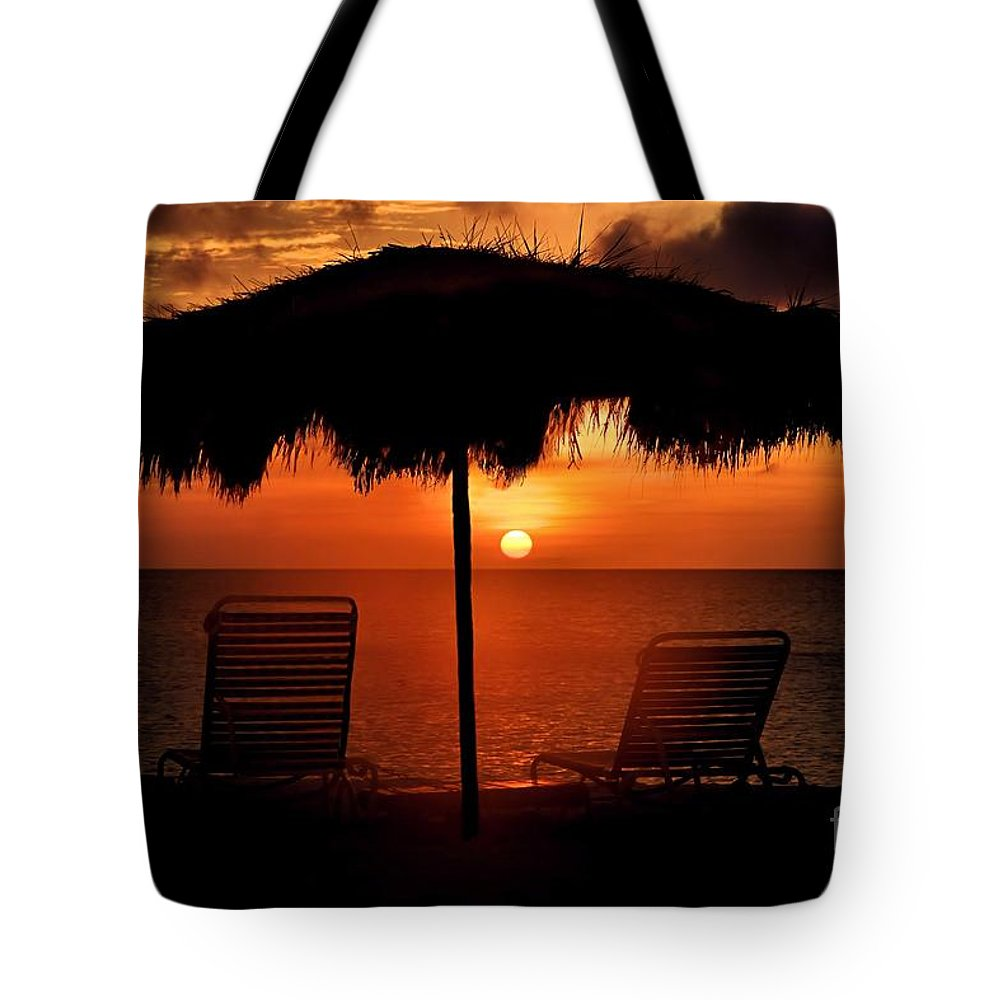 Sunset Tote Bag featuring the photograph Eagle Beach Sunset by DJ Florek