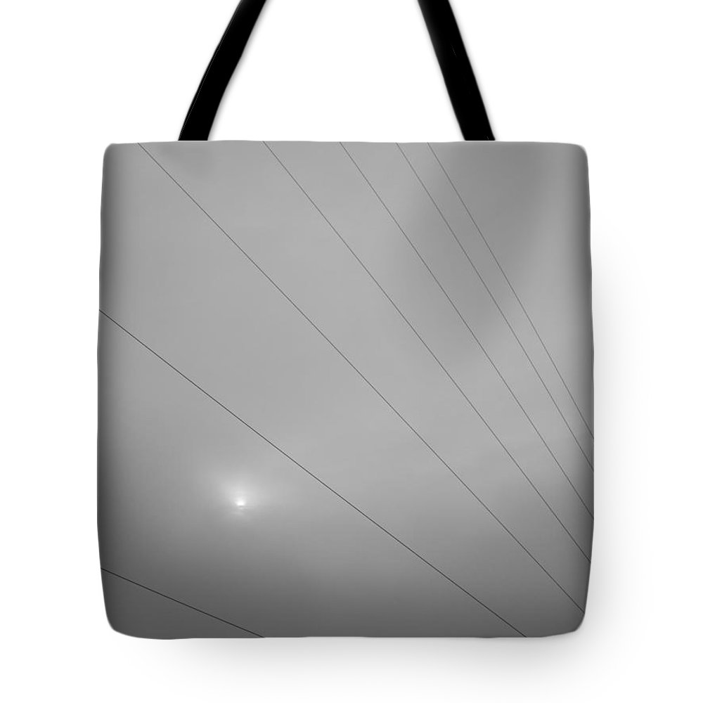Earths Guy Wires Tote Bag featuring the photograph Earths Guy Wires by Ed Smith