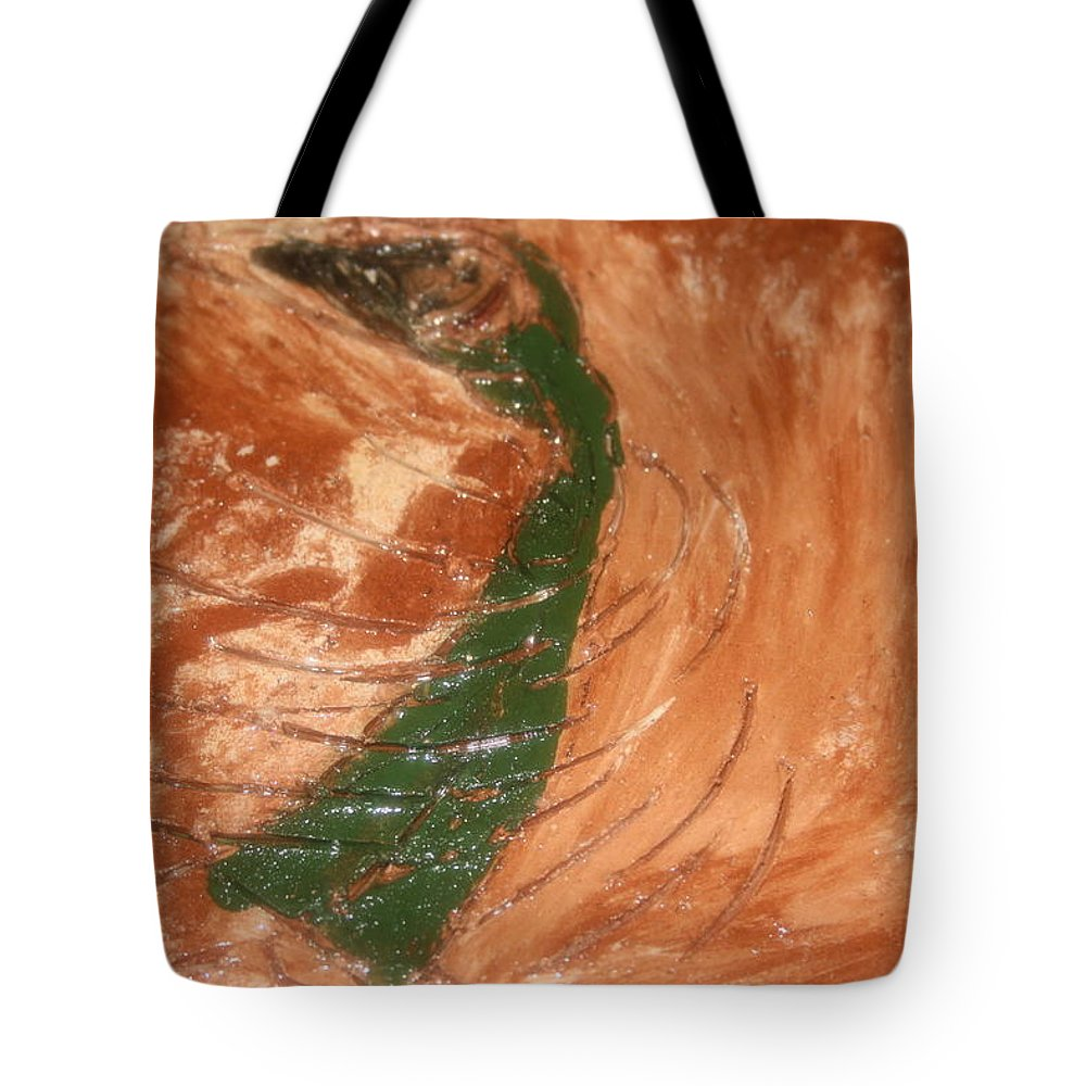Jesus Tote Bag featuring the ceramic art Earths Wind - Tile by Gloria Ssali