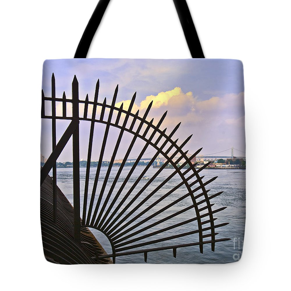 East River Tote Bag featuring the photograph East River View Through The Spokes by Madeline Ellis