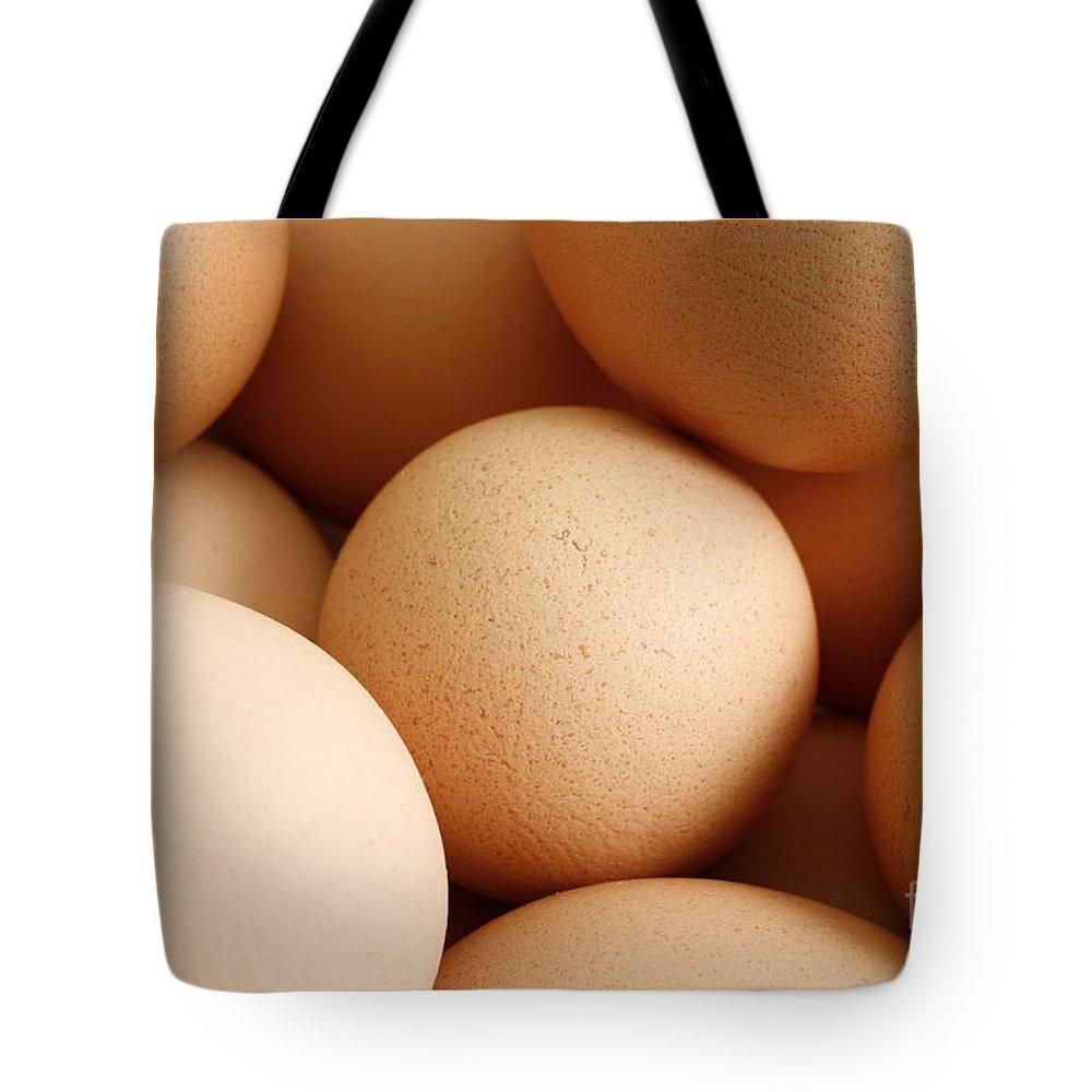Eggs Tote Bag featuring the photograph Eggs by Gaspar Avila