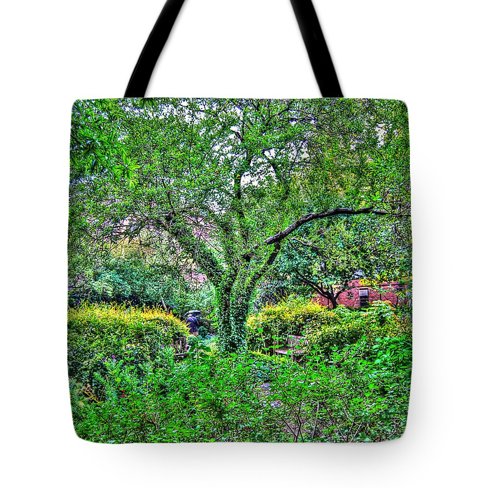 Greenwich Village Tote Bag featuring the photograph Elderly Man At St. Luke's Garden by Randy Aveille