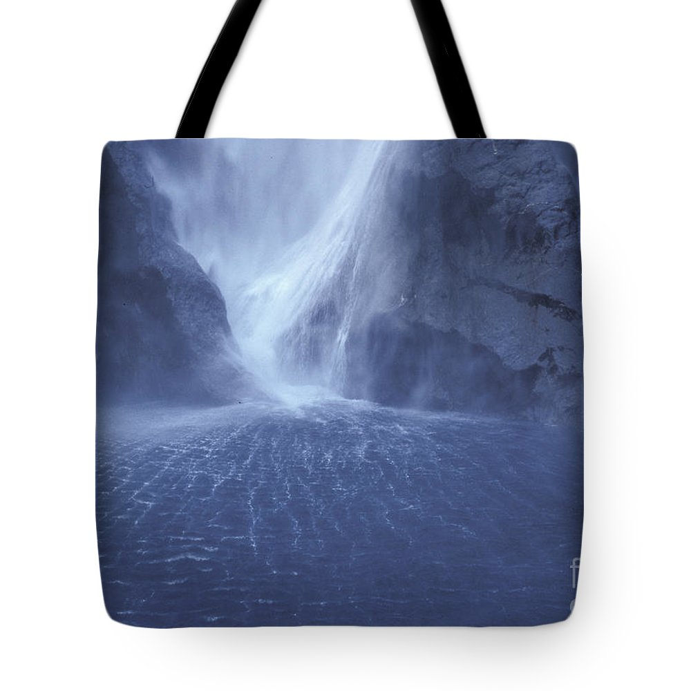 Milford Sound Tote Bag featuring the photograph Electric Water - Milford Sound by Sandra Bronstein