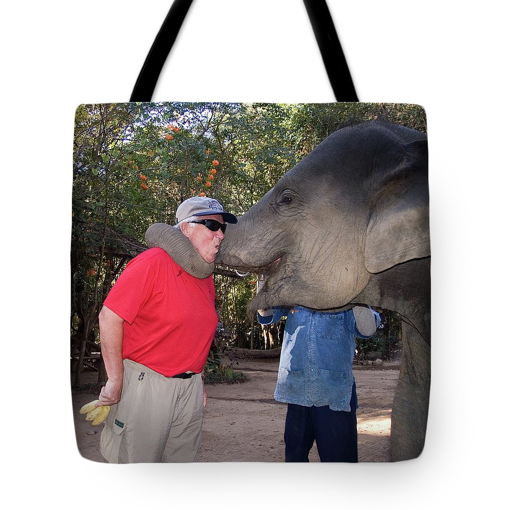 Man Holding Bananas Tote Bag featuring the photograph Elephant Kissing Man Holding Bananas by Sally Weigand