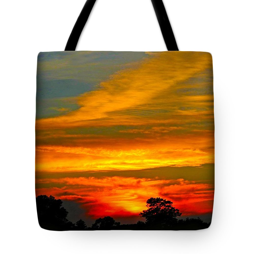 Sunset Tote Bag featuring the photograph Emerald Sunset by Mark Blauhoefer