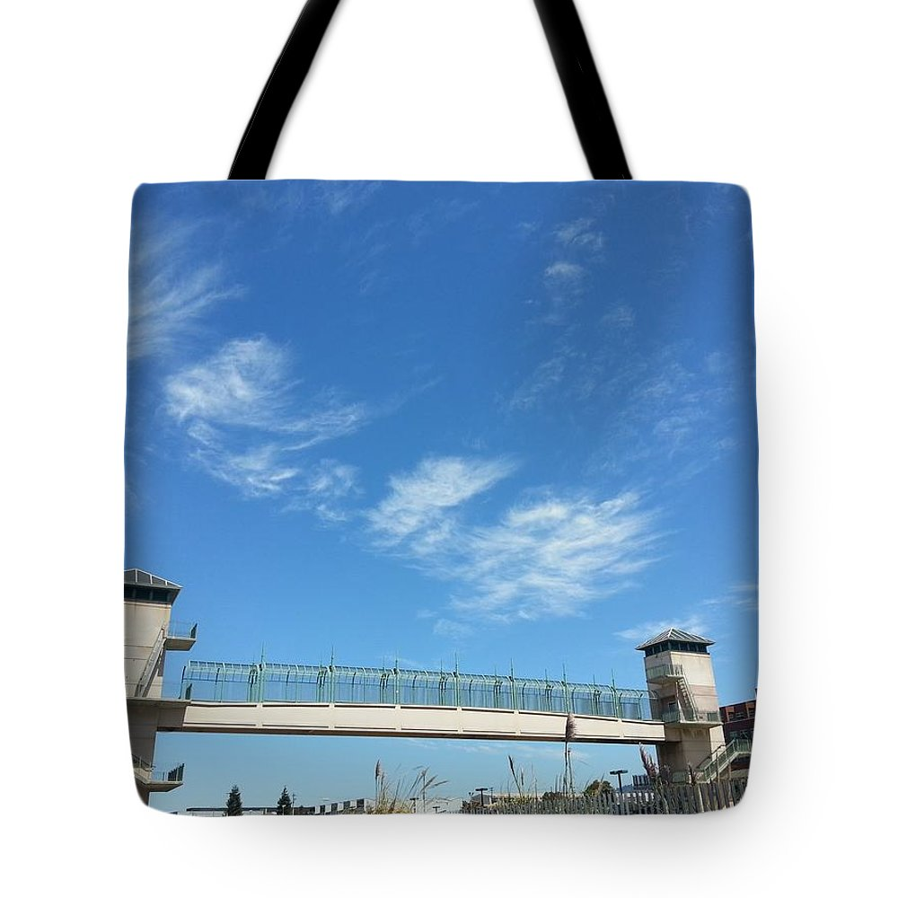 Emeryville Tote Bag featuring the photograph Emeryville Train Walk by Hugh Caley