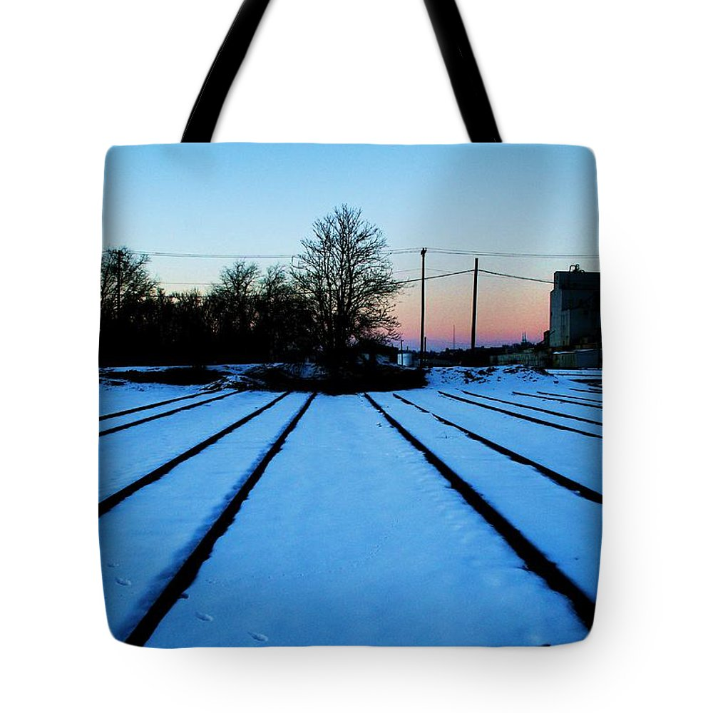Sunset Tote Bag featuring the photograph End Of The Tracks by Angus Hooper Iii