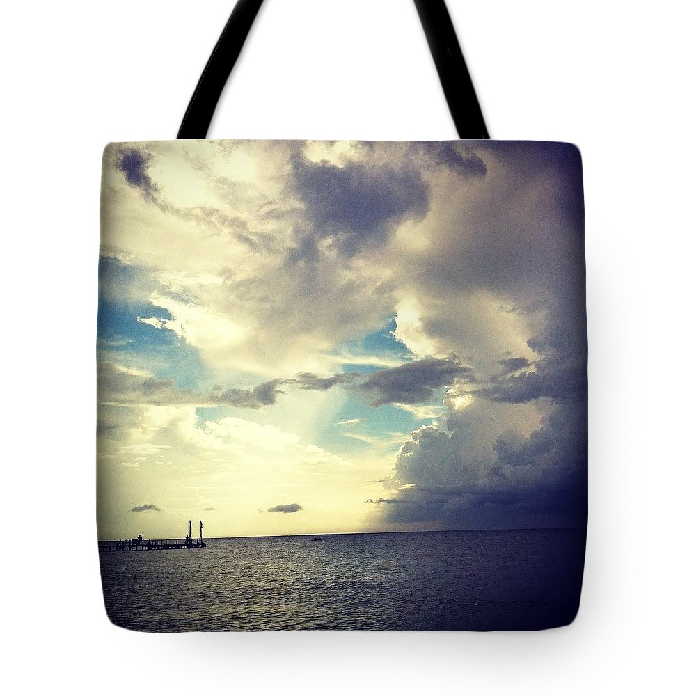 Ocean Clouds Tote Bag featuring the photograph End Of The World. by Sasha Kay