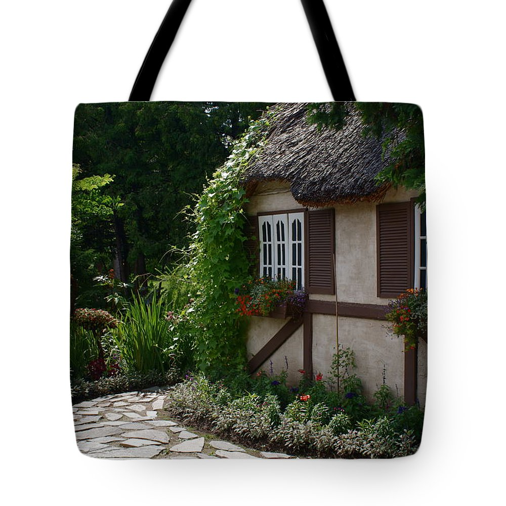 English Cottage At Leo Mol Gardens Assiniboine Park Winnipeg Tote Bag featuring the photograph English Cottage by Joanne Smoley