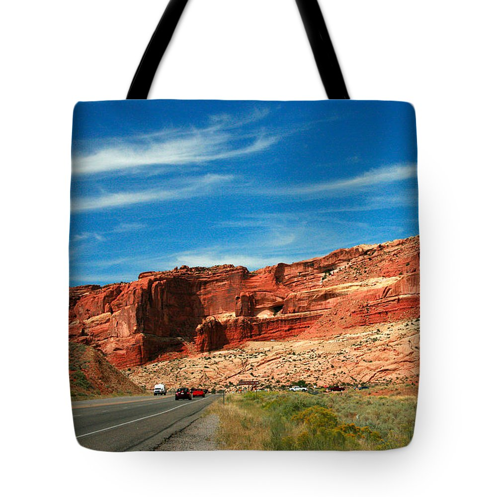 Arches National Park Tote Bag featuring the painting Entrance To Arches National Park by Corey Ford