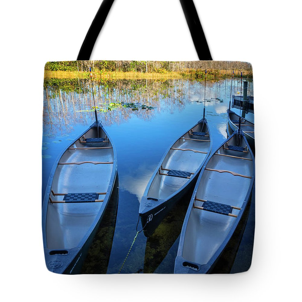 Boats Tote Bag featuring the photograph Evening Canoes At The Dock by Debra and Dave Vanderlaan